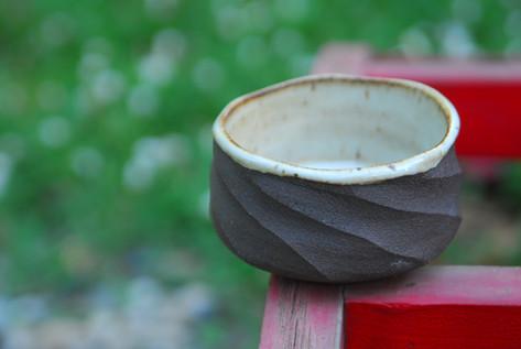 Black stoneware bowl with white interior