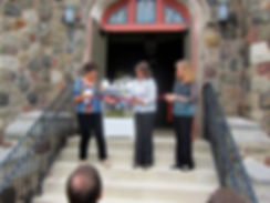 Mayor Ellen Dickson cut the ribbon held by Dreamcatcher's board president, Diane Gallo and Dreamcatcher's artistic director, Laura Ekstrand.