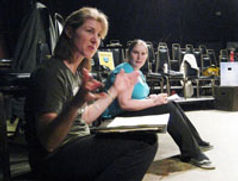 Director Laura Ekstrand and stage manager Erica Conrad give stage directions during rehearsal for The Pursuit of Happiness.