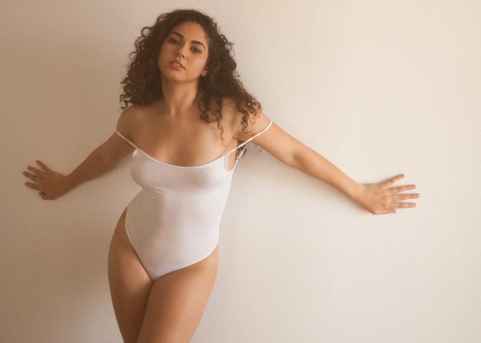 curvy-woman-curly-hair-boudoir.jpg