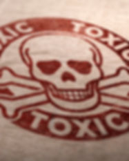 Toxic substances symbol over cardboard b