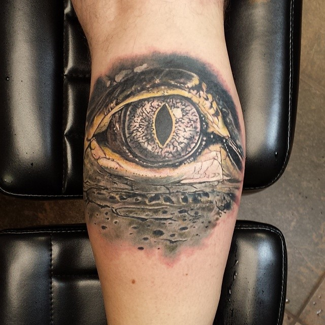 Gator eye tattoo