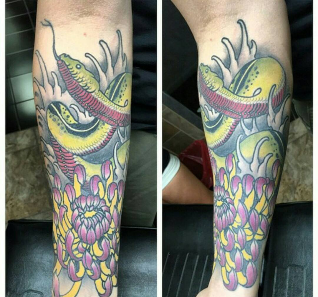 custom snake and flower tatttoo