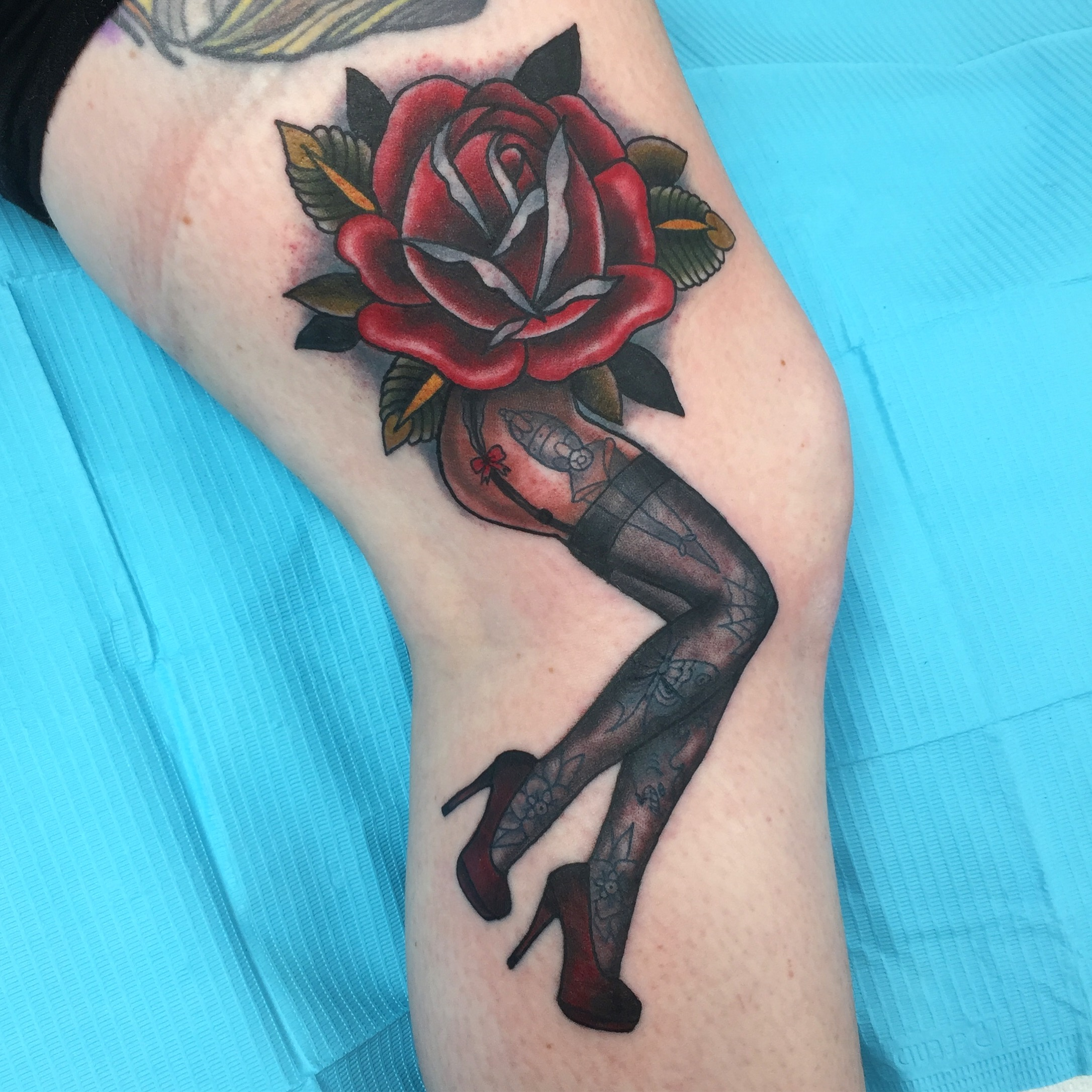 legs and roses tattoo