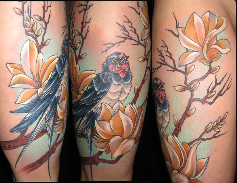 Blue bird and flowers tattoo