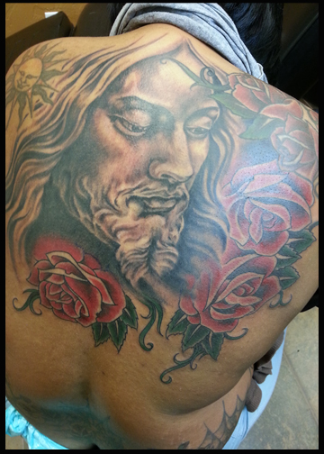 Jesus and roses tattoo