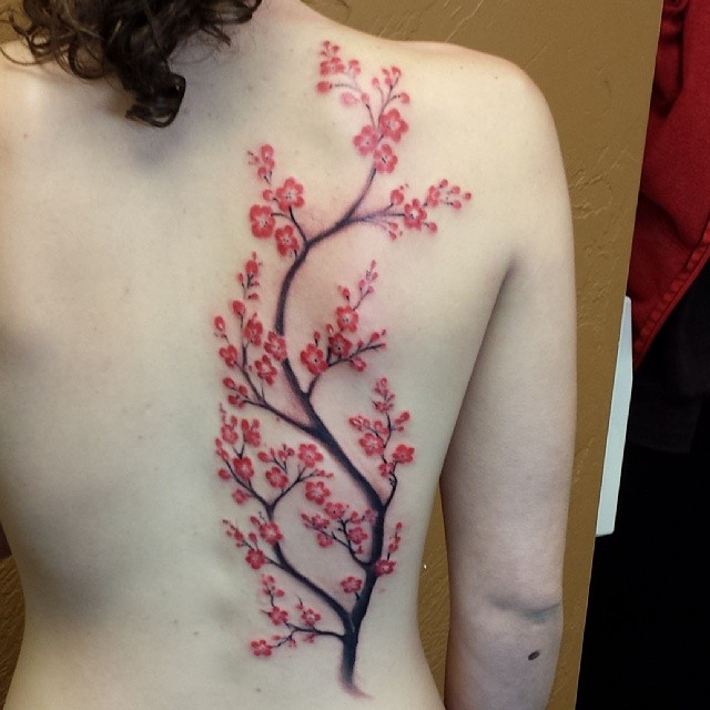 A fun little blossom branch tattoo