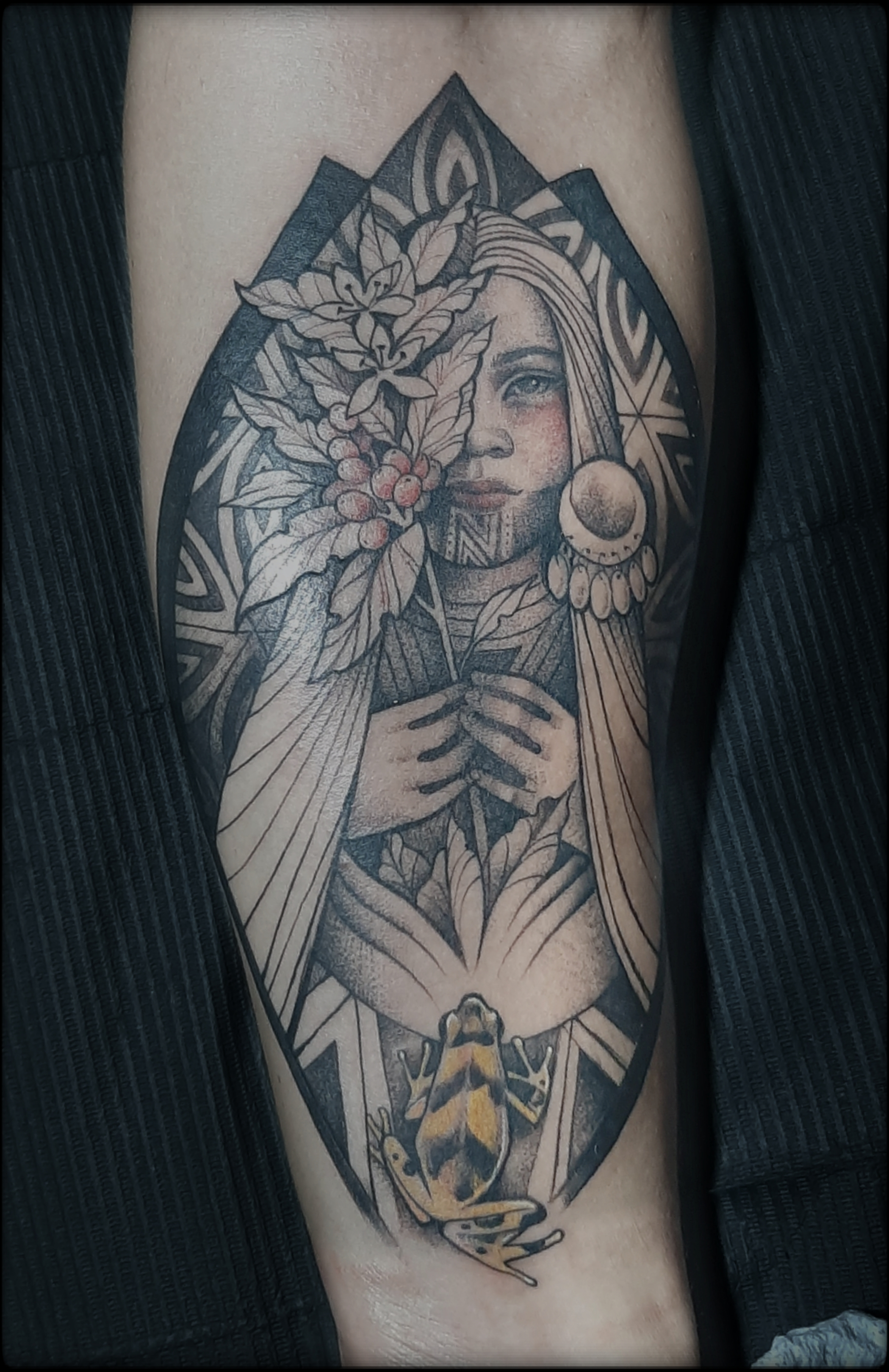 indigenous woman tattoo black and grey