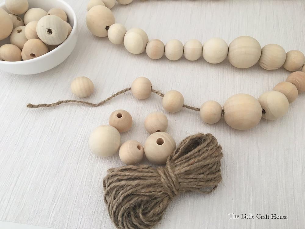 Threading a beaded garland