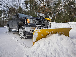 Truck Plow removing snow from parking lot