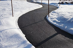 A clear walkway with ice melting salt