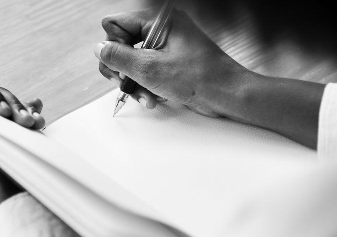 woman-writining-notebook.jpg