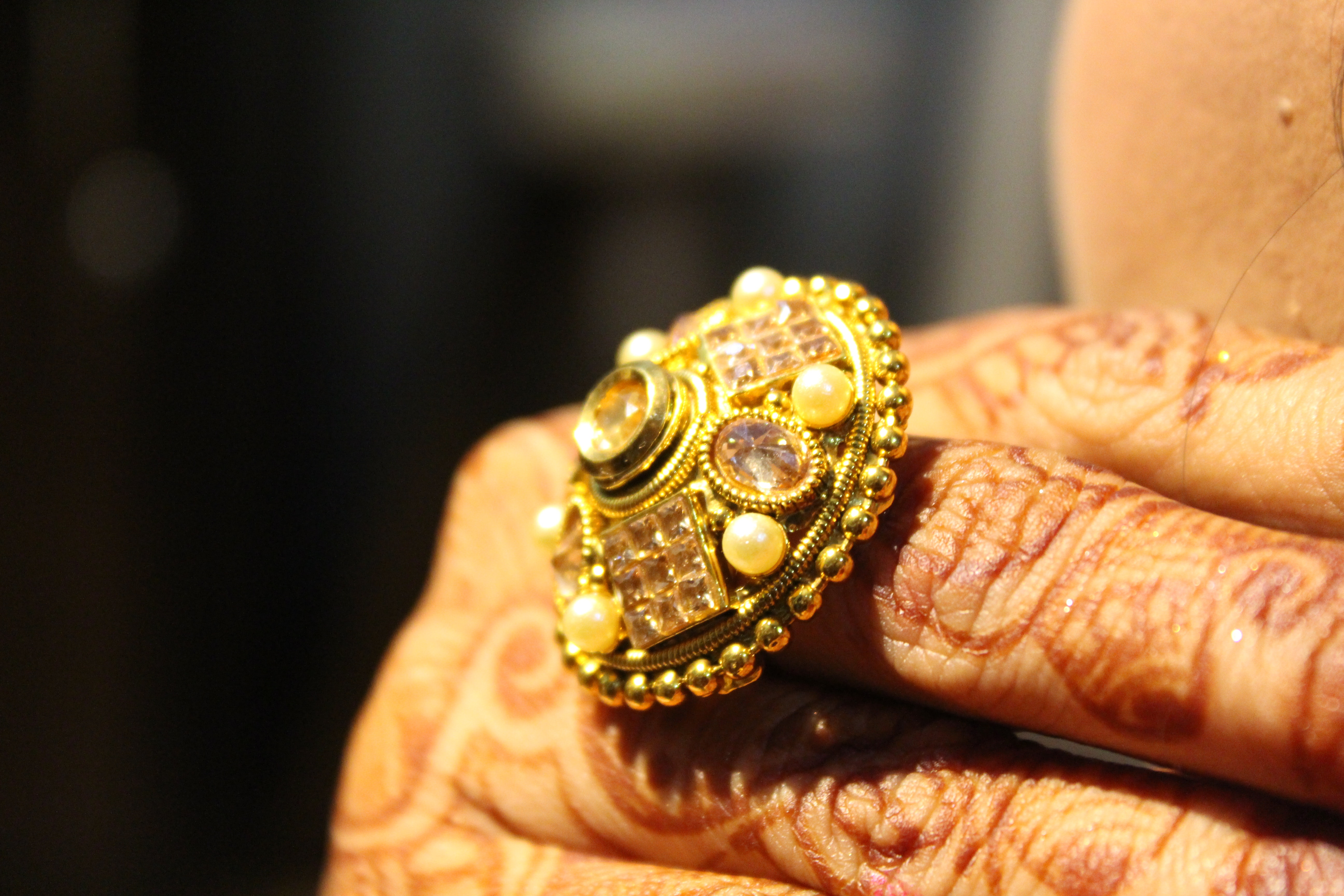 person-wearing-gold-colored-ring-1430956
