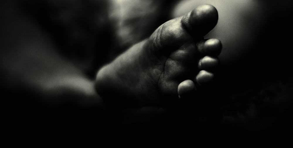 The Earth Underneath My Feet: Image showing the bottom of a tiny foot.