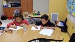 Some students writing a story to share with their classmates