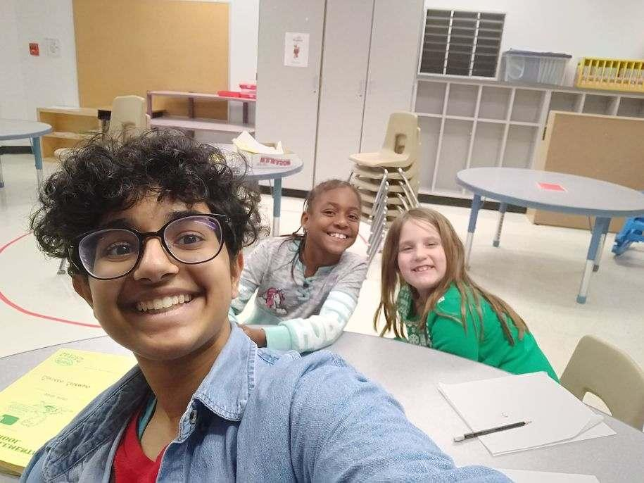 An instructor taking a selfie with her students