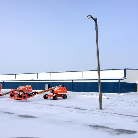 Pre-engineered metal building package and aerial lifts Perdue Arena.jpg