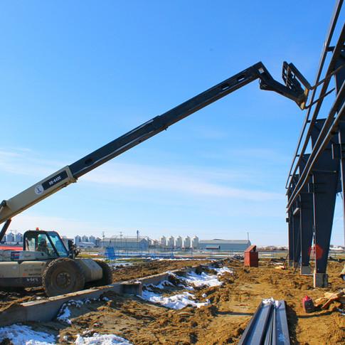 Telehandler Extended To Building Frame.J