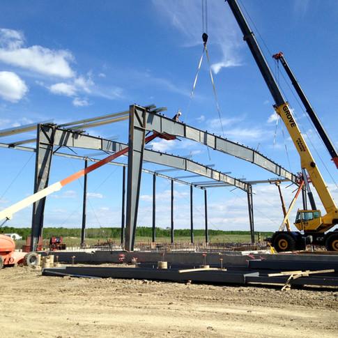 Ochapowace Arena Saskatoon pree-engineered metal building package construction crane and manlift.jpg