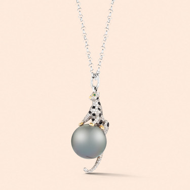 18k White Gold Snow Leopard Pendant with a Tahitian Pearl, Emeralds and Black and White Diamonds (1.40 tcw)