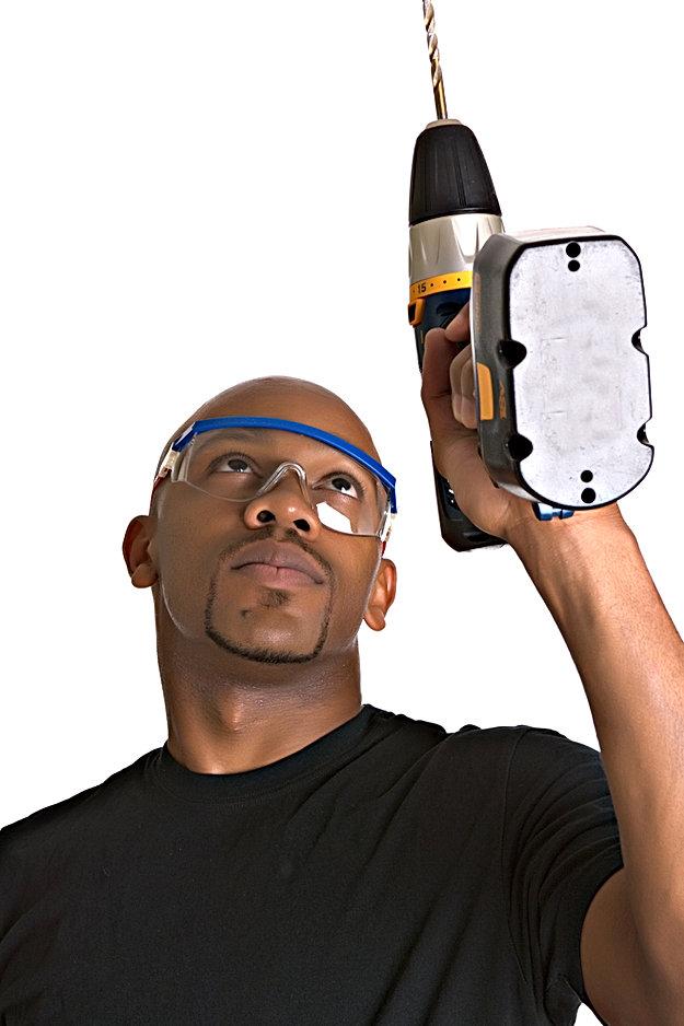 Handsome African-American repairman uses