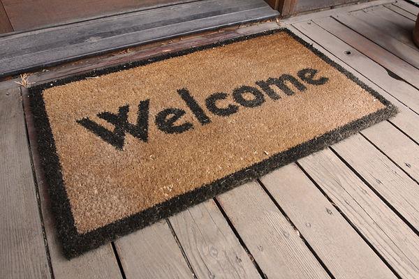 Welcome mat on a porch.jpg