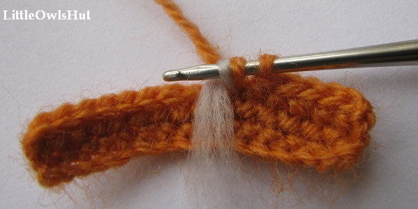 Bring the left tail of wool to the right side of your work.
