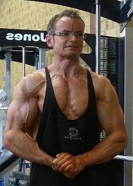 Sam gym most muscular.jpg