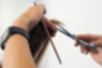 Picture of a hair dresser getting ready to cut hair | The Savvy Stylist