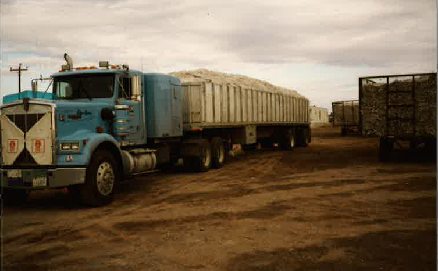 Mike Rowland hauling some grain for Keim in the Mid-80's. Stan's name is even on the truck!