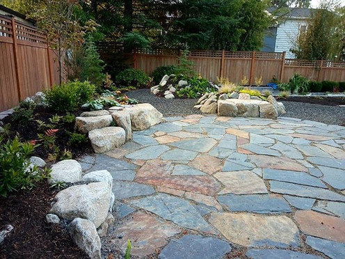 Patio with boulder benches