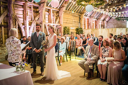 A couple getting married inside Stockbridge Farm Barn