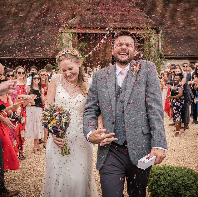 Newly weds showered with Confetti