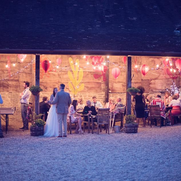 Wedding guests enjoying the courtyard at night