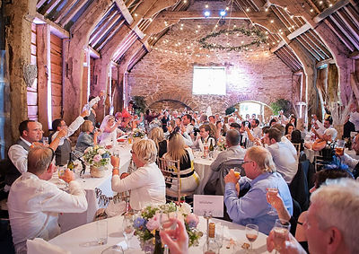 Wedding guests celebrating at Stockbridge Farm Barn