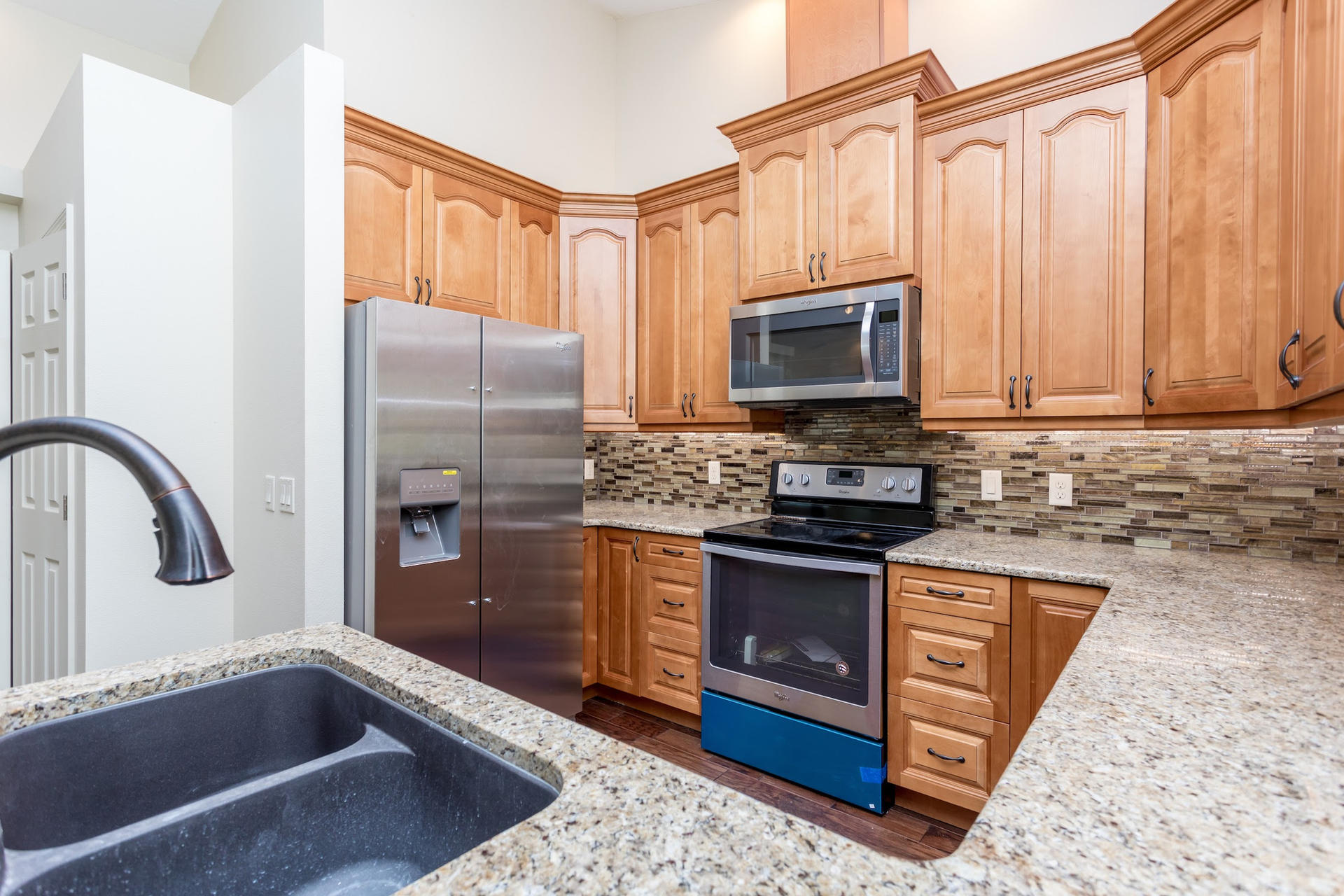PATRICIA kitchen with granite counter and wood cabinets