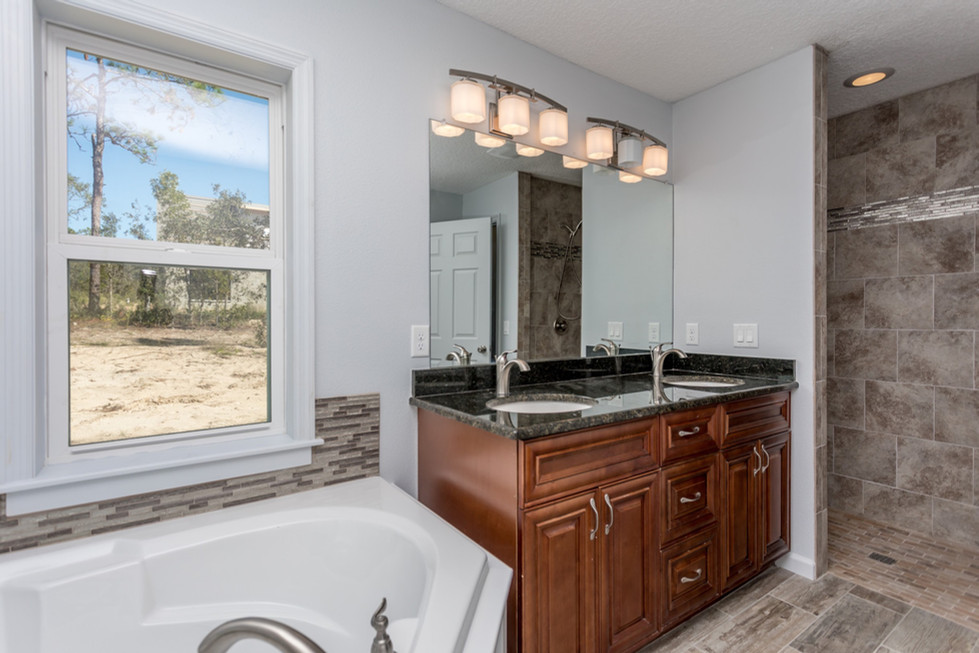 Ledgestone master bath including walk in shower