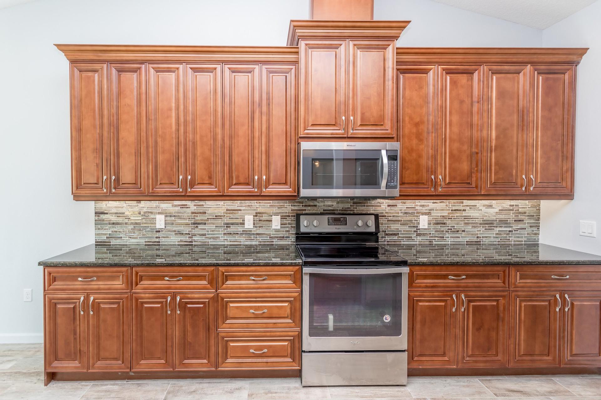 LEDGESTONE kitchen granite counter and wood cabinets