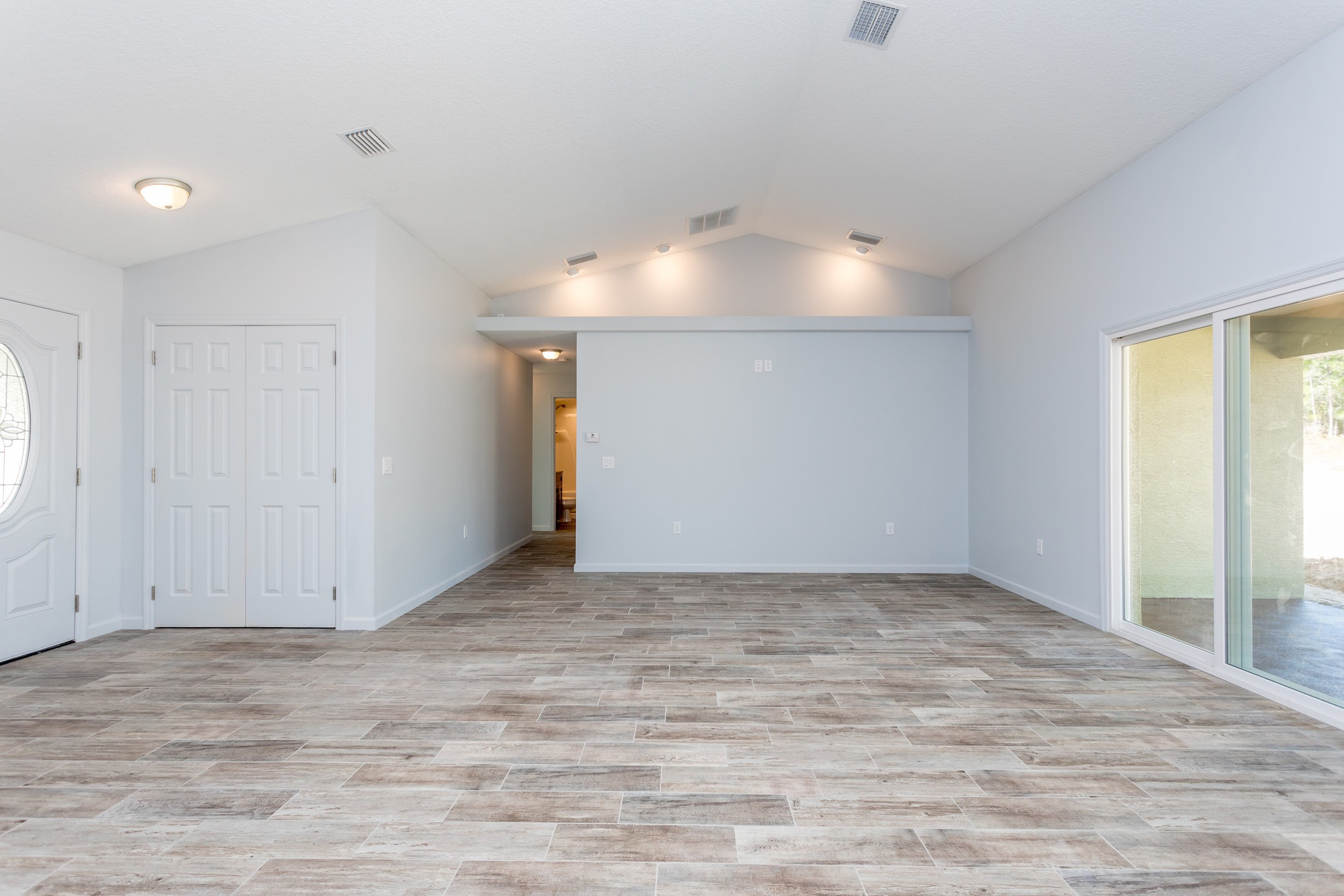 LEDGESTONE living room and entry from the kitchen