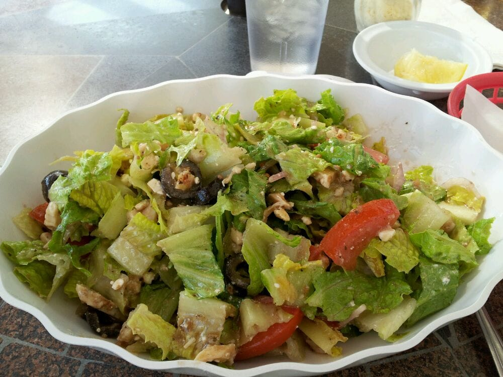 Greek salad with tender moist chicken added. Delicious house vinaigrette