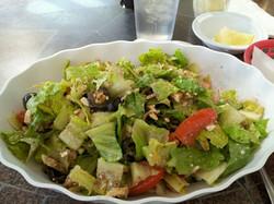 Greek salad with tender moist chicken added. Delicious house vinaigrette
