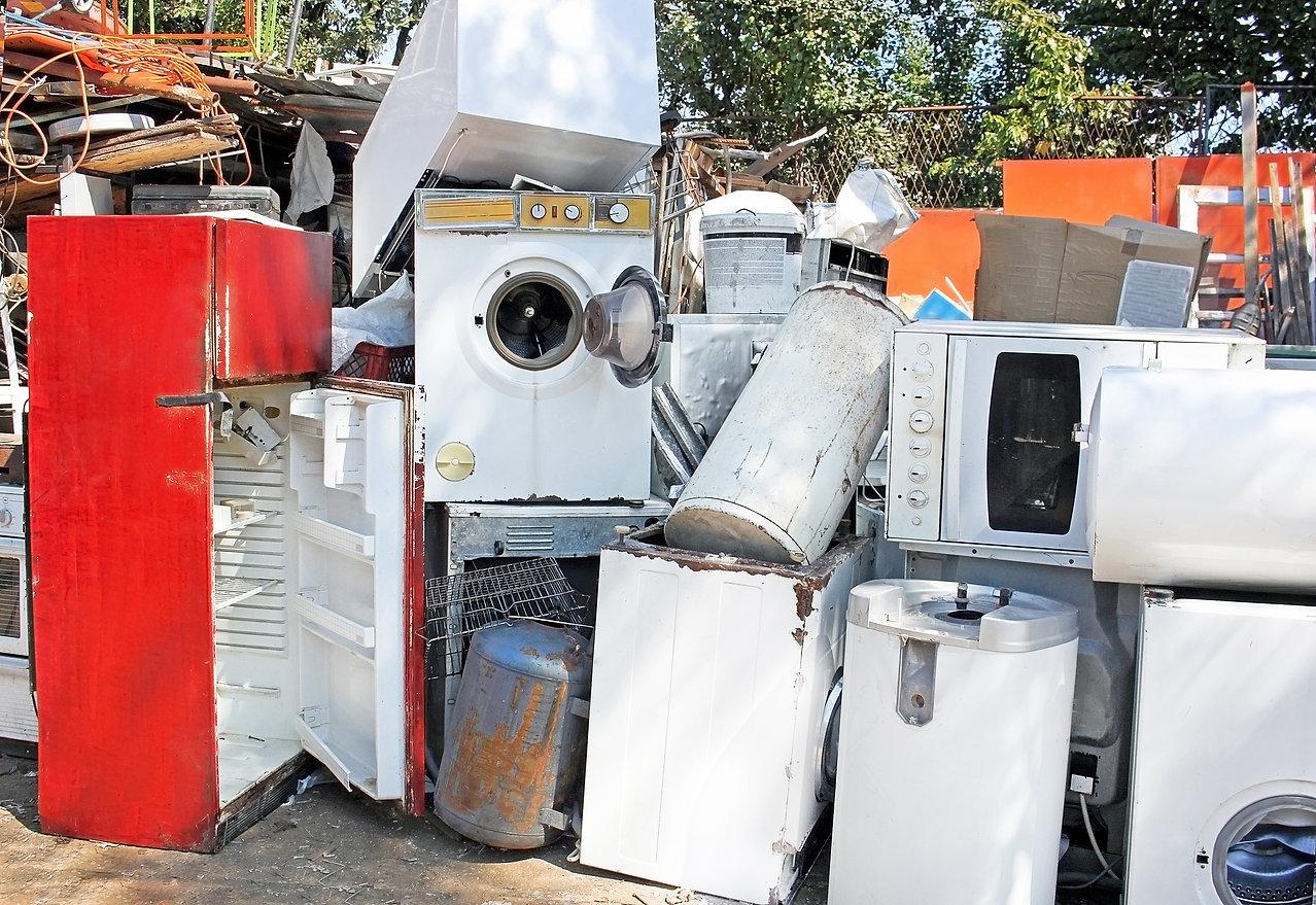 Broken scrap appliances outdoors on the junkyard.jpg