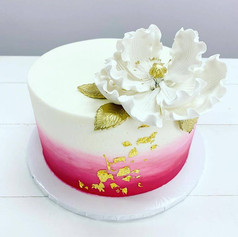 white pink and gold cake.jpg