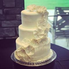 White Cascading Flowers Wedding Cake