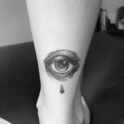 Eye engraved tattoo