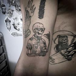 Chilling skull tattoo