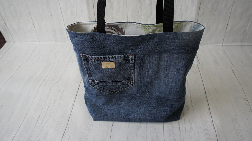 Upcycled blue jeans tote bag with recycled colourful lining fabric.