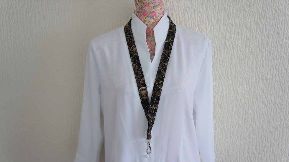 Lanyard with swivel clasp and safety break snap. Clocks cotton fabric