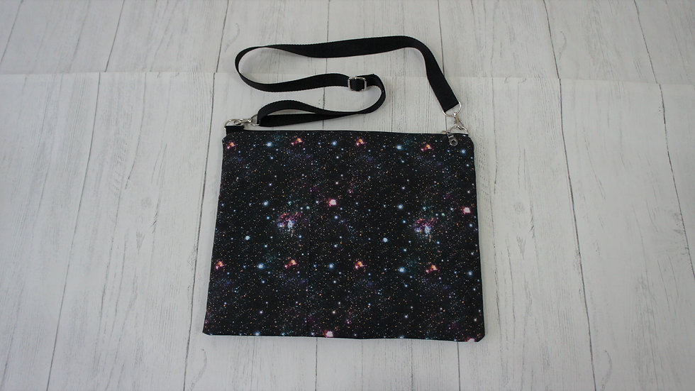 Galaxy print padded tablet bag with zip top and adjustable strap.