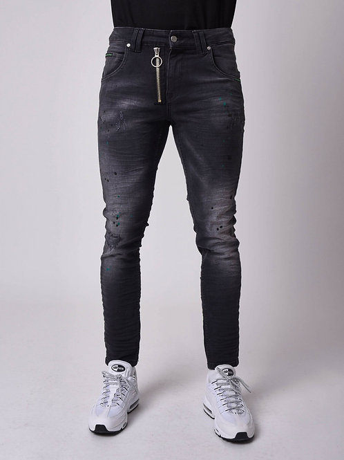 Jean skinny fit délavage noir, tacheté vert, zip apparent